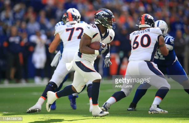 Royce Freeman of the Denver Broncos runs with the ball against the Indianapolis Colts at Lucas Oil Stadium on October 27, 2019 in Indianapolis,...