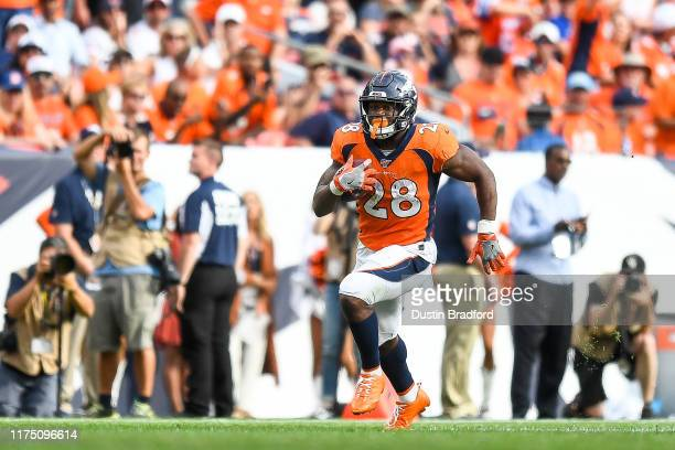 Royce Freeman of the Denver Broncos rushes against the Chicago Bears in the fourth quarter of a game at Empower Field at Mile High on September 15,...