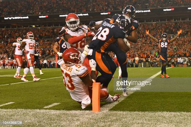 Royce Freeman of the Denver Broncos rushes for a touchdown during the second quarter against the Kansas City Chiefs. The Denver Broncos hosted the...
