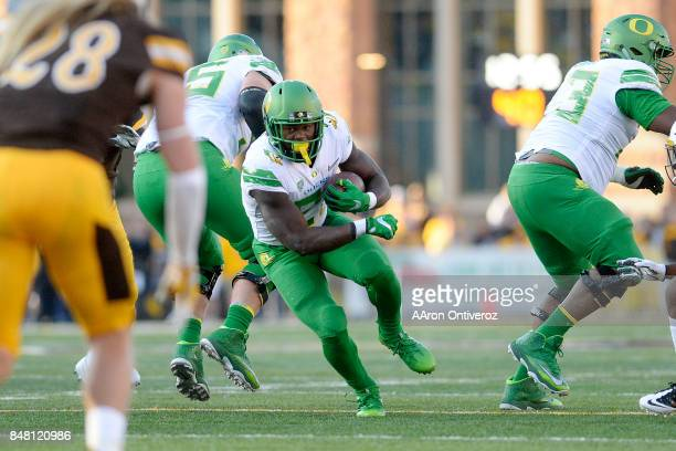Royce Freeman of the Oregon Ducks runs against the Wyoming Cowboys during the first half on Saturday, September 16, 2017. The Wyoming Cowboys hosted...