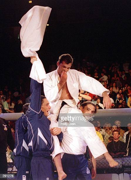 Royce Gracie , 4th-degree Jiu-Jitsu Black Belt, is lifted by members of his corner after beating Gerard Gordeau to win the Ultimate Fighting...