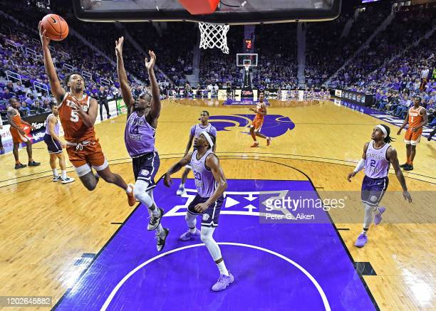 Royce Hamm Jr. #5 of the Texas Longhorns puts up a shot against Makol Mawien of the Kansas State Wildcats during the second half at Bramlage Coliseum...