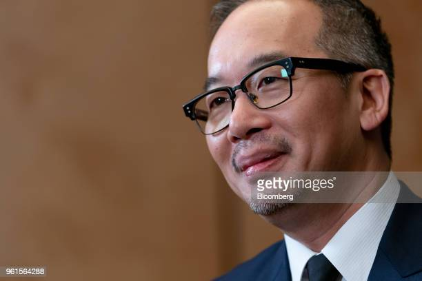Royce Hong chief executive officer of Xing Mobility Inc listens during a Bloomberg Television interview in Hong Kong China on Wednesday May 23 2018...