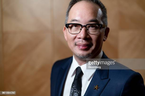 Royce Hong chief executive officer of Xing Mobility Inc poses for a photograph following a Bloomberg Television interview in Hong Kong China on...