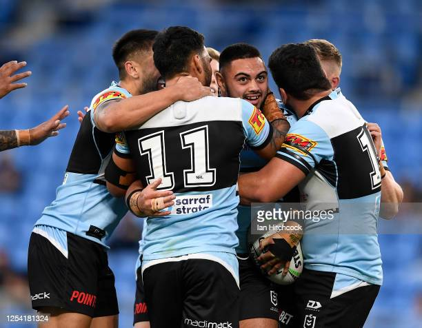 Royce Hunt of the Sharks celebrates after scoring a try during the round eight NRL match between the Gold Coast Titans and the Cronulla Sharks at...