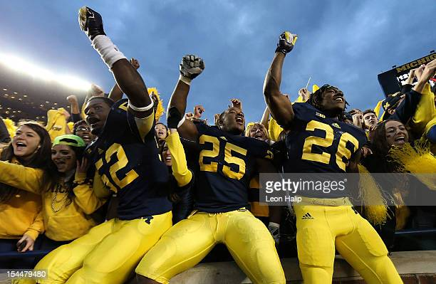 Royce JenkinsJones Kenny Demens and Dennis Norfeet of the Michigan Wolverines celebrate a win over the Michigan State Spartans at Michigan Stadium on...