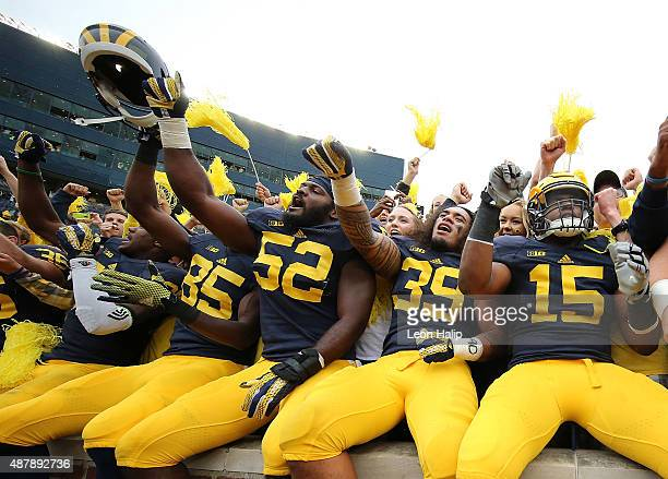 Royce JenkinsStone and Ty Isaac of the Michigan Wolverines celebrate a win over the Oregon State Beavers on September 12 2015 at Michigan Stadium in...