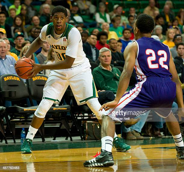 Royce O'Neale of the Baylor Bears brings the ball up court against the Northwestern State Demons on December 18 2013 at the Ferrell Center in Waco...