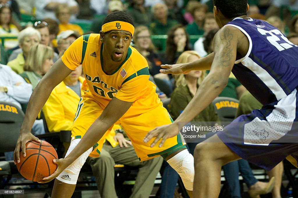 Royce O'Neale #00 of the Baylor Bears brings the ball up court against the TCU Horned Frogs on January 11, 2014 at the Ferrell Center in Waco, Texas.