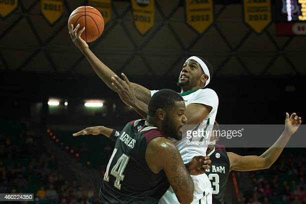 Royce O'Neale of the Texas AM Aggies drives to the basket against the Texas AM Aggies on December 9 2014 at the Ferrell Center in Waco Texas