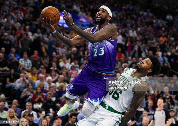 Royce O'Neale of the Utah Jazz attempts a shot over Marcus Smart of the Boston Celtics during a game at Vivint Smart Home Arena on February 26 2020...