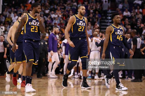 Royce O'Neale Rudy Gobert and Donovan Mitchell of the Utah Jazz during the first half of the NBA game against the Phoenix Suns at Talking Stick...