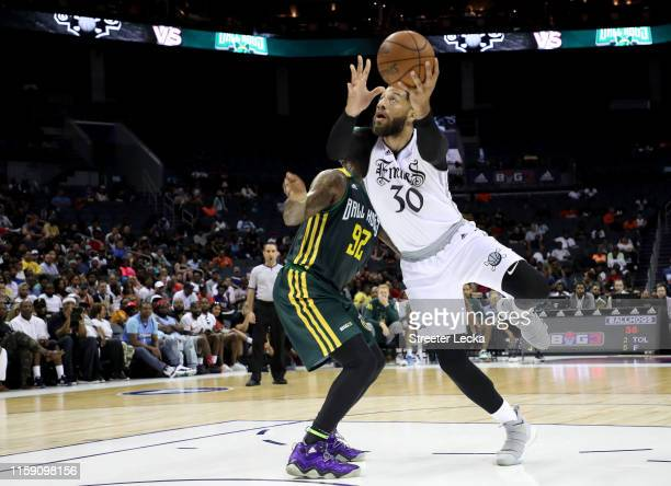 Royce White of Enemies drives to the basket against DeShawn Stevenson of Ball Hogs during week two of the BIG3 three on three basketball league at...