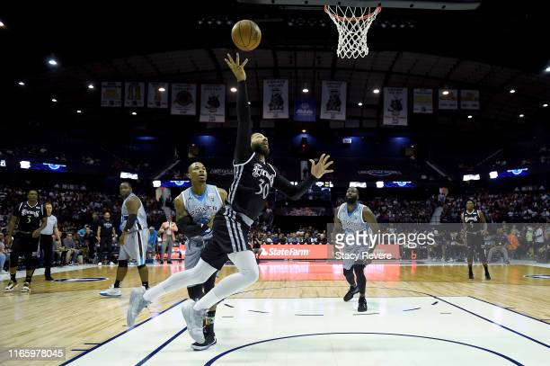 Royce White of the Enemies attempts a shot while being guarded by Corey Maggette of the Power in the second half during week seven of the BIG3 three...