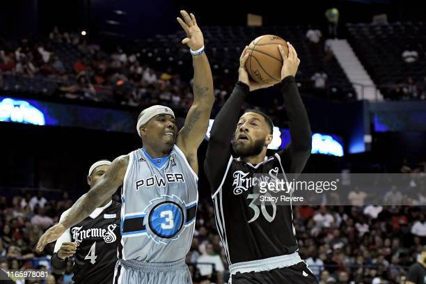 Royce White of the Enemies attempts a shot while being guarded by Quentin Richardson of the Power in the second half during week seven of the BIG3...