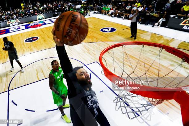 Royce White of the Enemies dunks the ball against the Aliens during week four of the BIG3 three on three basketball league at Dunkin' Donuts Center...