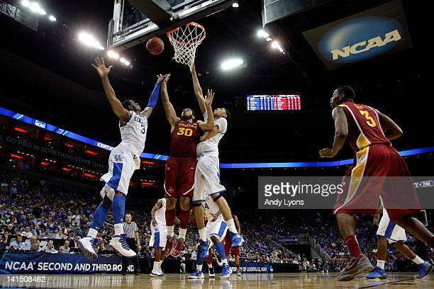 Royce White of the Iowa State Cyclones attempts a shot against Terrence Jones and Anthony Davis of the Kentucky Wildcats during the third round of...