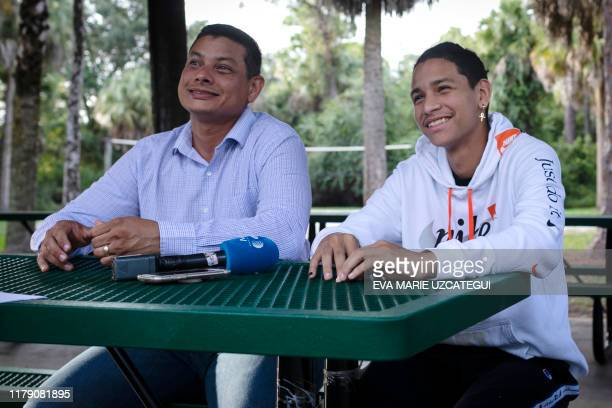 Royer Borges and his son Marjory Stoneman Douglas High School shooting survivor Anthony Borges speak during an interview with AFP, in Coral Springs,...