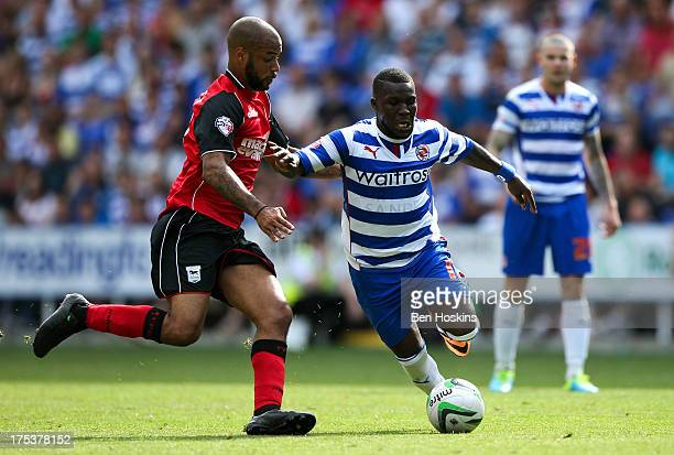 Royston Drenthe of Reading holds off the challenge of David McGoldrick of Ipswich during the Sky Bet Championship match between Reading and Ipswich...