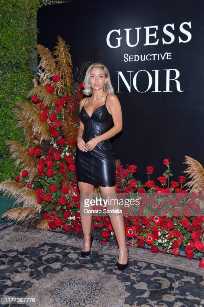 Roz attends GUESS Celebrates Launch Of New Fragrance Seductive Noir For Men Women at No Vacancy on September 26 2019 in Los Angeles California
