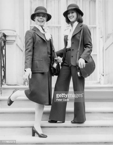 Roz Hanby from London and Elinor Christie from Glasgow modelling the two styles of new uniform for British Airways female staff with each dark blue...