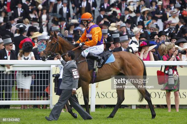 Roz ridden by Kieron Fallon going to post for the Coronation Stakes