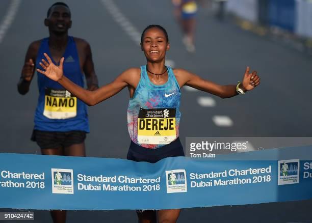Roza Dereje Bekele of Ethiopia crosses the finish line to win the Standard Chartered Dubai Marathon on January 26 2018 in Dubai United Arab Emirates