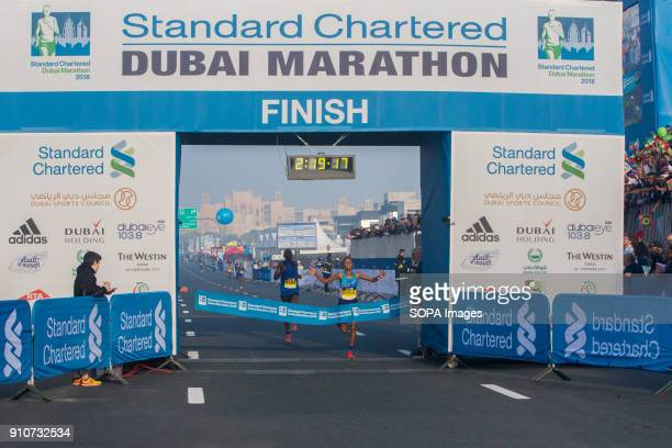 Roza Dereje of Ethiopia crosses the line to win the Standard Chartered Dubai Marathon 2018 in a new course record time of 21917