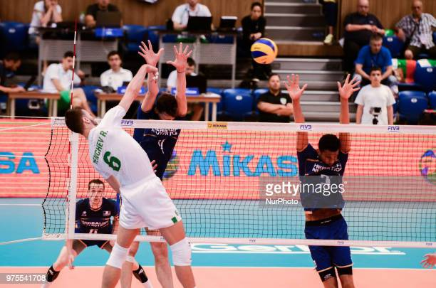 Rozalin Penchev Bulgaria L and Barthelemy Chinenyeze France R during Mens Volleyball Nations League VNL match between Bulgaria and France in Varna...