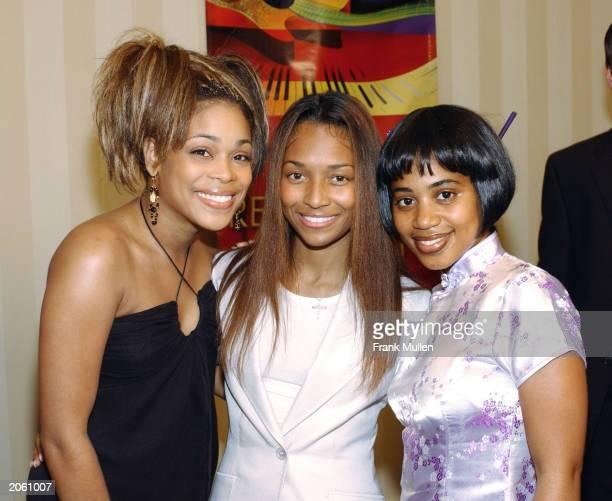 ATLANTA JUNE 5 Rozonda Chili Thomas and Tionne TBoz Watkins of TLC with Raina Lopes sister of Lisa LeftEye Lopes before the 2nd Annual Atlanta Heroes...
