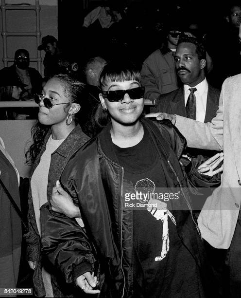 Rozonda Chilli Thomas and Lisa Left Eye Lopez of TLC attend LaFace holiday party for families with kids in Atlanta Georgia December 18 1992