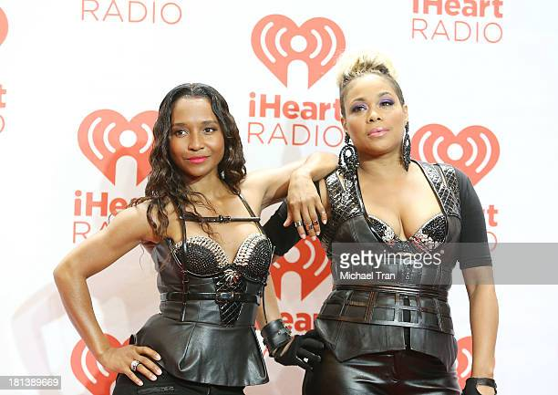 Rozonda 'Chilli' Thomas and Tionne 'TBoz' Watkins arrive at the iHeartRadio Music Festival press room held at MGM Grand Arena on September 20 2013 in...