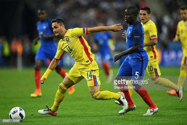 rpm14 and N'Golo Kante of France compete for the ball during the UEFA Euro 2016 Group A match between France and Romania at Stade de France on June...