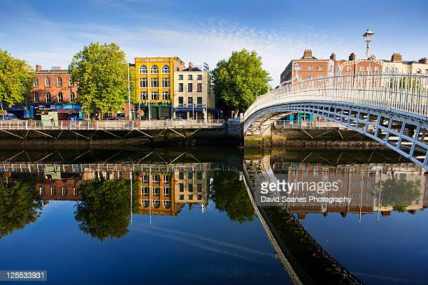 rreflections of bridge and buildings - dublin stock pictures, royalty-free photos & images