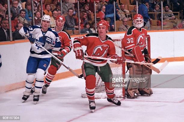 Rsndy Velisheck and Alain Chevrier of the New Jersey Devils skate against Steve Thomas the Toronto Maple Leafs during NHL game action on March 22...