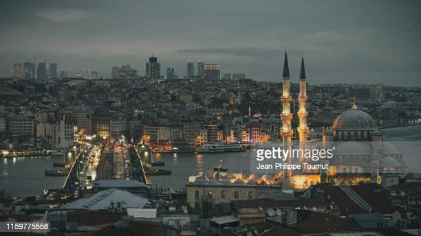 rüstem pasha ottoman mosque and galata bridge over the golden horn at dusk, istanbul, turkey - istanbul bildbanksfoton och bilder