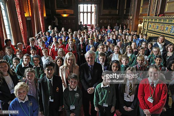 Rt Hon John Bercow MP and Speaker of the House of Commons poses for a photo with school children during an EU Referendum Debate in Speaker's House on...