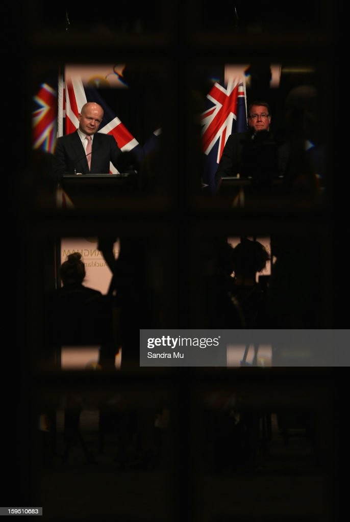 Rt Hon William Hague, Secretary of State for Foreign and Commonwealth Affairs United Kingdom of Great Britain and Northern Ireland (L) and Hon Murray McCully, New Zealand Minister of Foreign Affairs are seen in the reflection of the doors as they speak to media representatives at the joint media conference after a Bilateral meeting at The Langham Hotel on January 15, 2013 in Auckland, New Zealand. The Right Honourable William Hague is visiting New Zealand for bilateral meetings and a tour through the red zone of earthquake stricken Christchurch.
