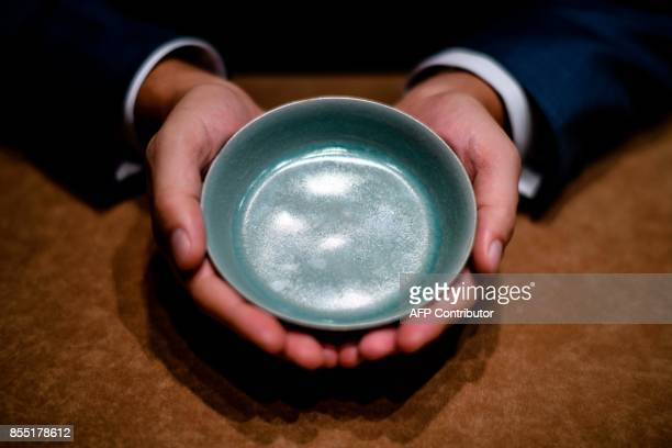 A Ru guanyao brush washer from the court ware of the late Northern Song dynasty is displayed by Nicolas Chow Deputy Chairman for Sotheby's Asia...