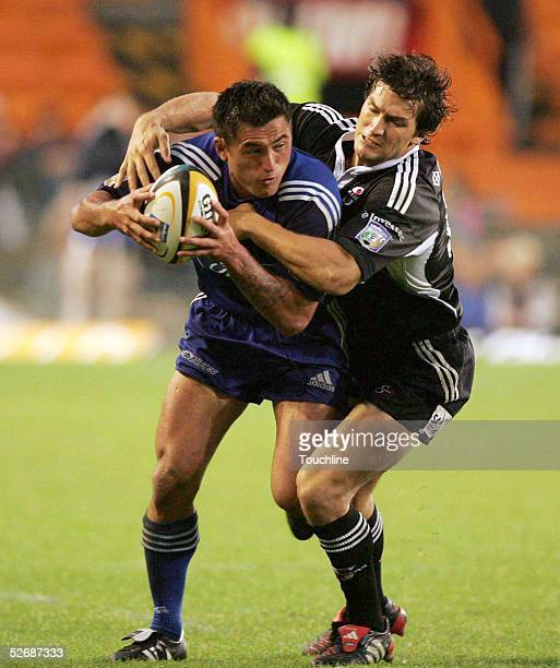 Rua Tipuki is stopped by Gaffie du Toit during the Super 12 match between the Investec Stormers and the Blues on April 23, 2005 at Newlands stadium...