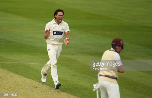 Ruaidhri Smith of Glamorgan celebrates after taking the wicket of Jamie Overton of Somerset during Day One of the Bob Willis Trophy match between...