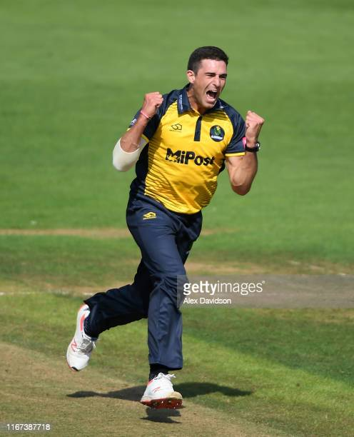 Ruaidhri Smith of Glamorgan celebrates the wicket of Aaron Finch of Surrey during the Vitality Blast match between Glamorgan and Surrey at Sophia...