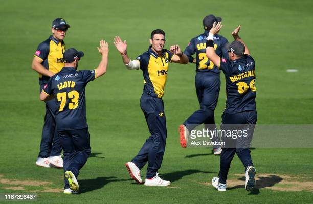 Ruaidhri Smith of Glamorgan celebrates the wicket of Mark Stoneman of Surrey with his teammates during the Vitality Blast match between Glamorgan and...