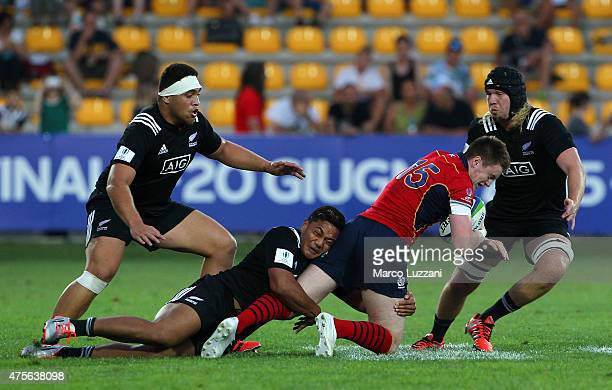 Ruairi Howarth of Scotland is tackled by Nathaniel Apa of New Zealand during the World Rugby U20 Championship 2015 match New Zealand and Scotland...