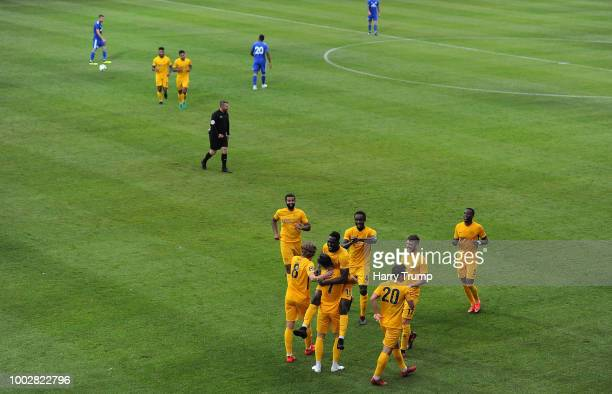 Ruairi Keating of Torquay United celebrates after scoring his sides first goal with team mates during the PreSeason Friendly match between Torquay...