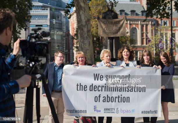 Ruairi Rowan of FPA Sharon Hodgson MP Anna Soubry MP Diana Johnson MP Jess Phillips MP and Clare Murphy of BPAS by the statue of Millicent Fawcett in...