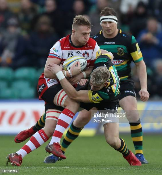 Ruan Ackermann of Gloucester is tackled by Harry Mallinder during the Aviva Premiership match between Northampton Saints and Gloucester Rugby at...