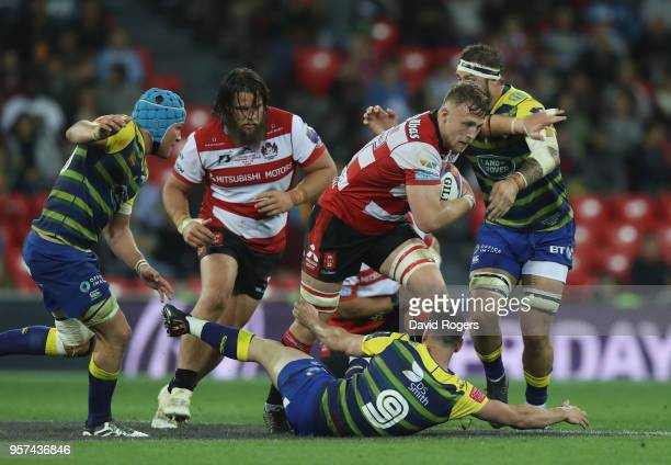 Ruan Ackermann of Gloucester Rugby breaks through the Cardiff Blues defence during the European Rugby Challenge Cup Final match between Cardiff Blues...