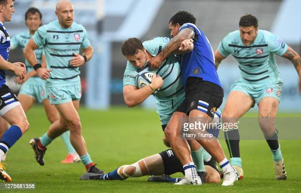 Ruan Ackermann of Gloucester Rugby is tackled by Josh Matavesi of Bath Rugby during the Gallagher Premiership Rugby match between Bath Rugby and...