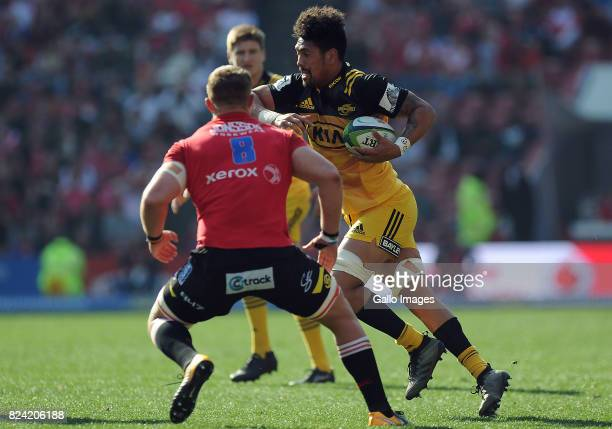Ruan Ackermann of Lions in action with Ardie Savea of Hurricane during the Super Rugby Semi Final match between Emirates Lions and Hurricanes at...